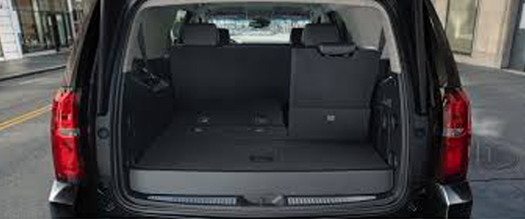 Rear trunk view of Chevy Suburban SUV rental in Miami